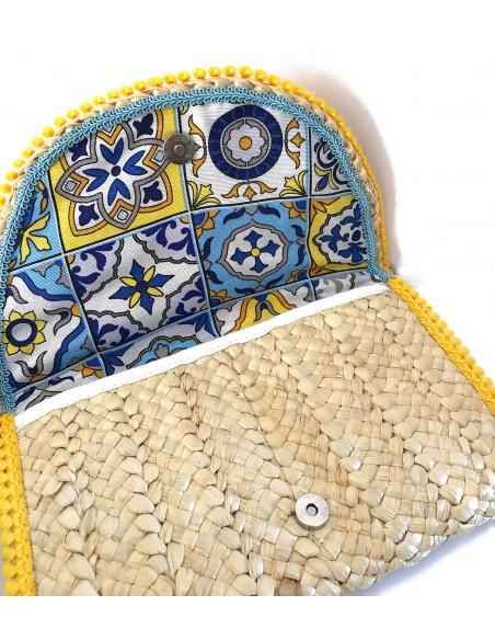 pochette da mare in paglia con decoro siciliano maioliche